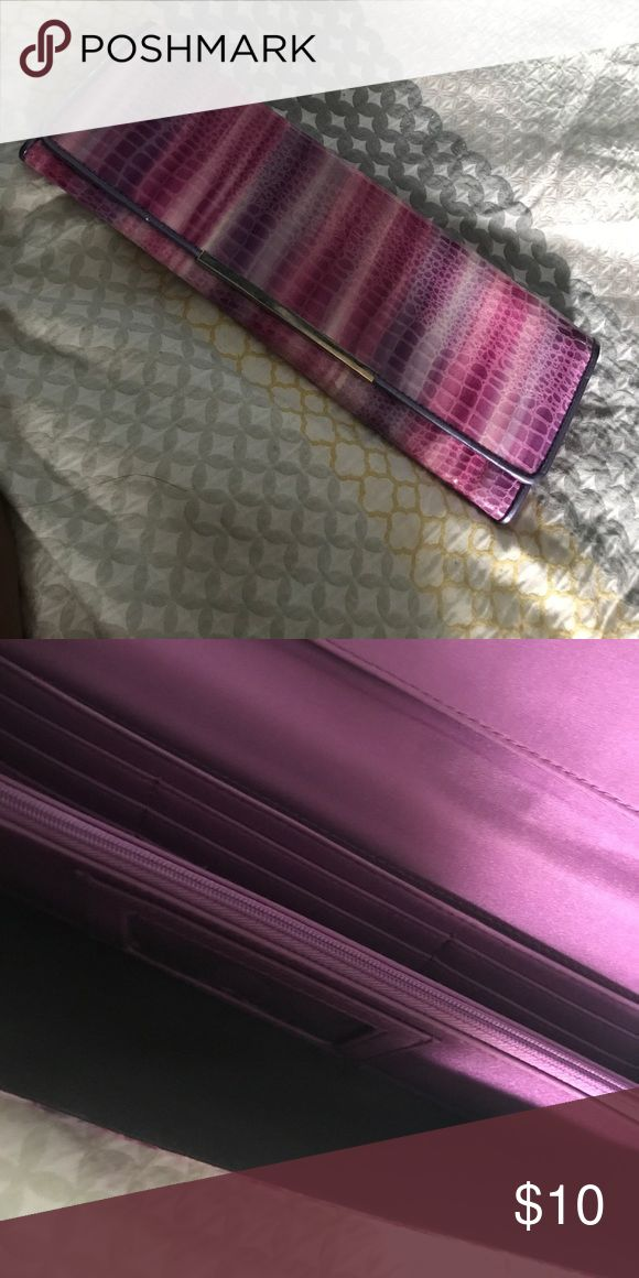 Pink and purple clutch Used once, plenty of storage options for cards, zipper pocket and ID holder. Silver detailing Bags Clutches & Wristlets