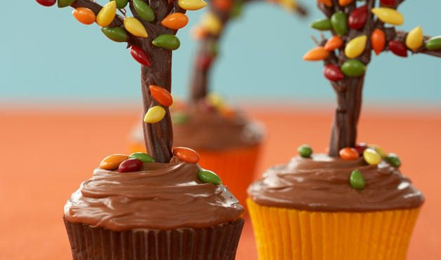 Tree cupcakes   Chocolate dipped pretzels covered with candy coated sunflower seeds
