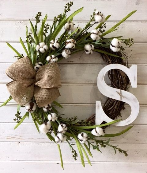 This 18 grapevine wreath is a classic addition to your farmhouse décor. The wreath would be lovely on your front door or hanging on your wall to complete your farmhouse look. The wreath features faux cotton and greenery with a timeless burlap bow. The bow is handmade using a wire ribbon which can be fluffed and shaped once received. This wreath also features a wooden monogram letter of your choice, is hand painted then ruffed up a bit for a weathered look.  This wreath would also make a…