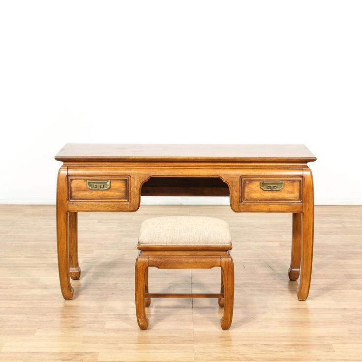This writing desk is featured in a solid wood with a glossy cedar finish. This Chinese style table and bench set have an upholstered linen seat, chow legs, h-stretchers, and carved panels. Elegant desk that's perfect for getting work done! #asian #desks #writingdesk #sandiegovintage #vintagefurniture