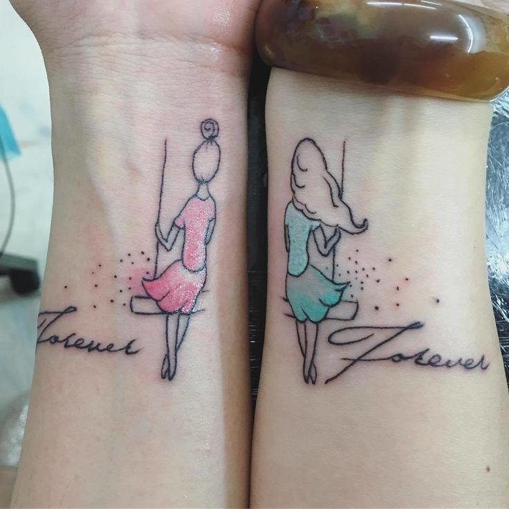 "These pretty wrist tattoos illustrate the two friends swinging together when shown side-by-side. The word ""Forever"" is elegantly scripted next to cartoon likenesses of each other -- how cute is that?"