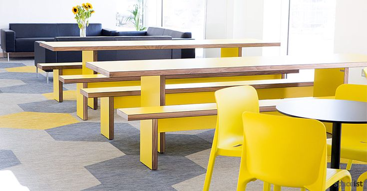 Yellow school canteen tables and benches for Sir John Cass Hall in Hackney, London.