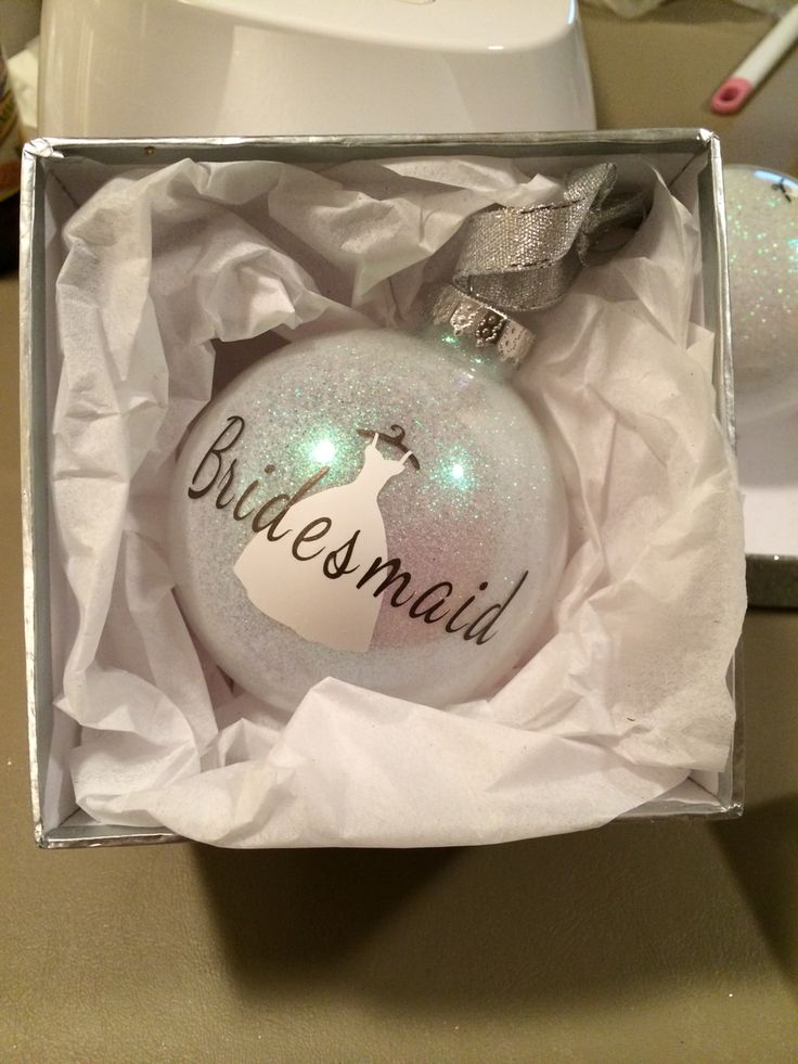 Cute way to ask bridesmaids to be in your wedding...especially a winter wedding.  Glass ornament, mop and glo and glitter. Cut dress and words with a cricut.
