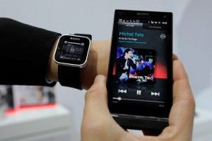 February 28, 2012 Mobile World Congress in Barcelona, ??a man with a Sony SmartWatch displays during a presentation. Mobile World Congress Sony mobile phone during a presentation at the Sony SmartWatch conected. SmartWatch your smartphone directly