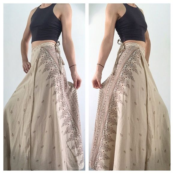 SEXY INDIAN TRIBAL BOHO WRAP COTTON MAXI SKIRT A beautiful, long, cotton, floor length skirt with tribal patterns. This skirt wraps around and you can tie it however you like. The beautiful details in the design make this piece a show stopper. Made in India. Will fit size XS-M. Skirts Maxi