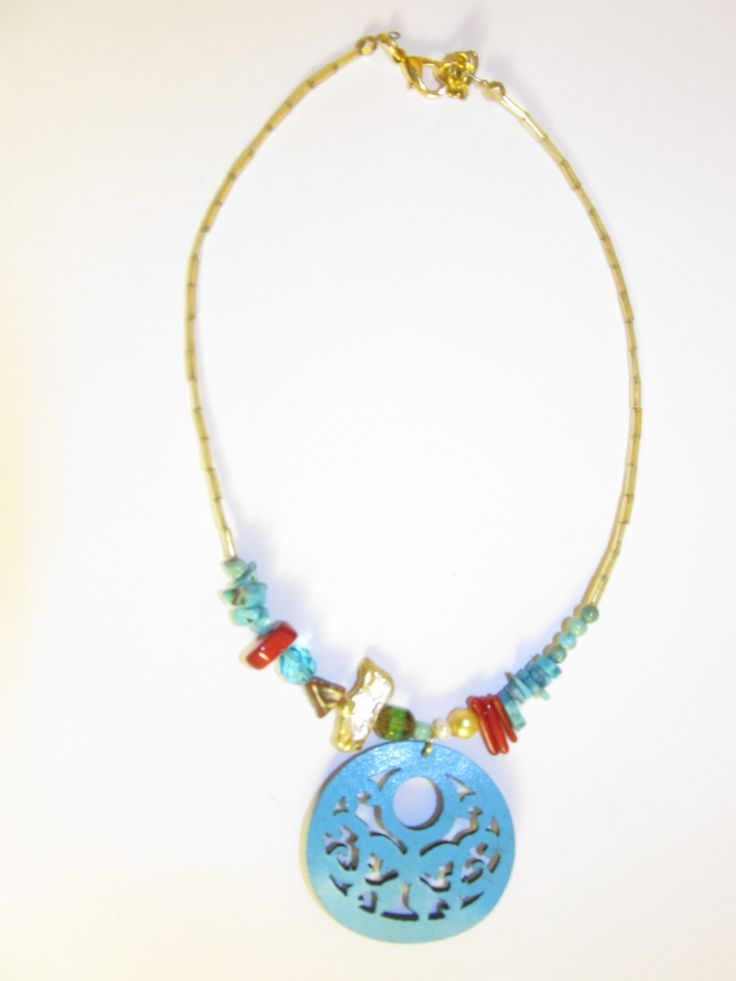 Handmade short leather necklace (1 pc)  Made with turquoise leather filigree, freshwater pearl, turquoise stones, corals and glass beads.