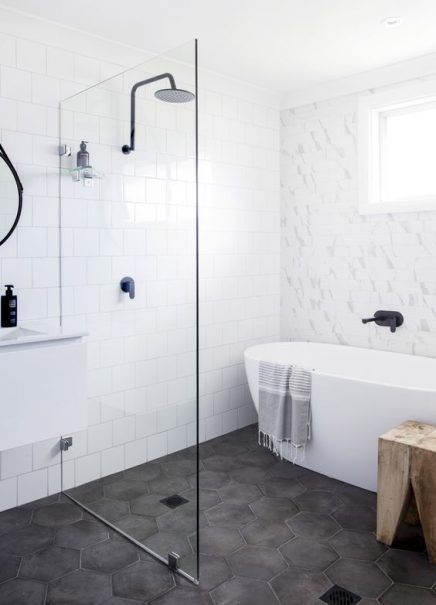 Grey ground tiles, shower and bath combo