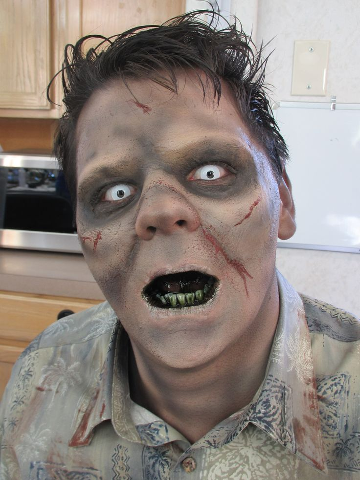 For gross Zombie teeth, a quick trick is to mix black food coloring in with mouthwash. Swish a little bit of it in your mouth and spit out the excess and you'll have nice minty fresh breath with really gross teeth. Make sure to be careful if you have dentures or veneers as it may cause some staining on artificial teeth. Another great addition to this look is eating a few Oreo cookies. If you get some stuck in your teeth it really adds to the gunky teeth effect.