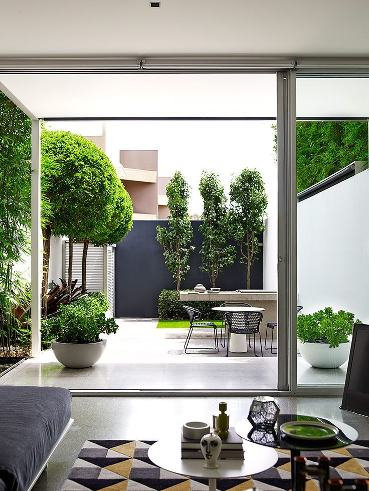 small but perfectly formed garden space with feature bowl planters…