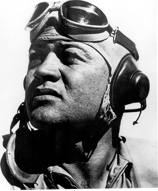 """December 4. 1912: Pappy Boyington, American pilot, is born (d. 1988). Colonel Gregory """"Pappy"""" Boyington, USMC, was an American fighter ace. He commanded the famous U. S. Marine Corps squadron, VMF-214 (""""The Black Sheep Squadron"""") during World War II. Boyington became a prisoner of war later in the war. He was awarded the Navy Cross and the Medal of Honor."""