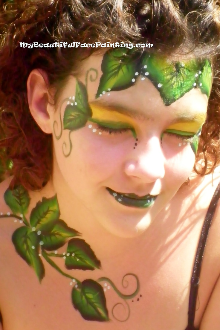 Poison Ivy face paint. Yellow background-Starblend powder. Leaves and lips-Tag small leaf split.  Outline-DFX black. White dots-DFX.