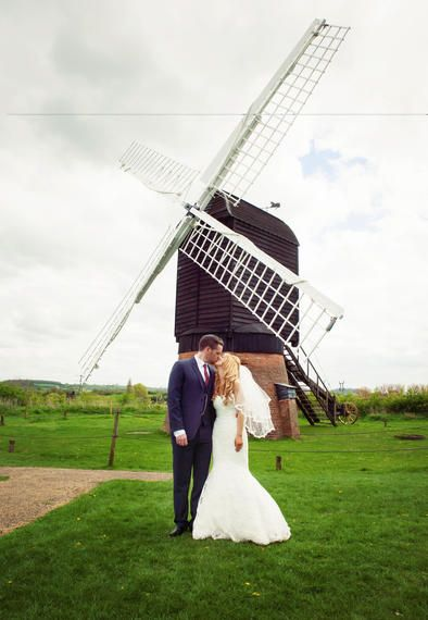 Bride and groom kissing, outside the Windmill at Avoncroft Museum of Historic Buildings (avoncroft.org.uk). Rosie Kelly Photography