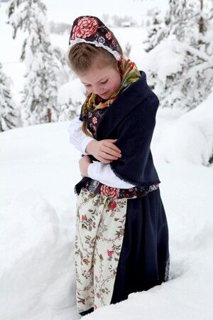Girl in Ringerike bunad from Norway -and we love her 'kyse', the traditional hat.