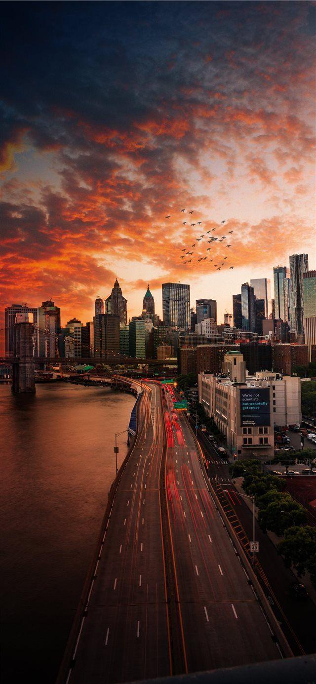 Sunset over Manhattan Bridge iPhone X wallpaper – Kristal Beltre