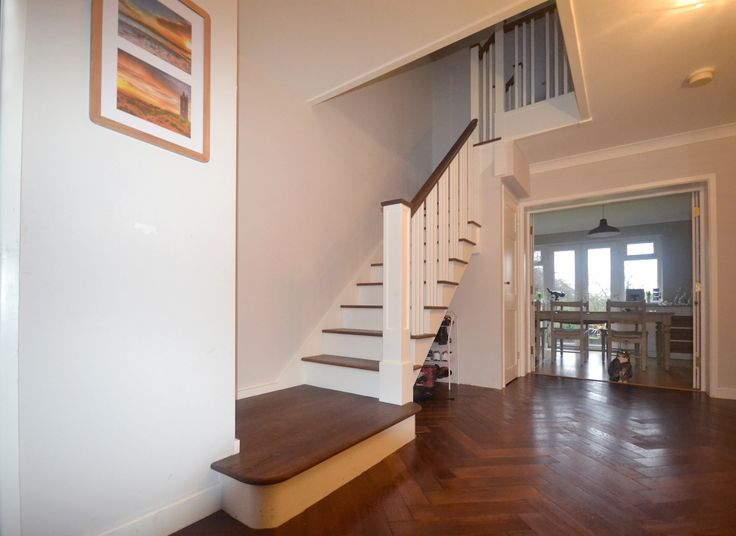 Beautiful new set of custom made stairs using multiple colours of wood to match this lovely home.