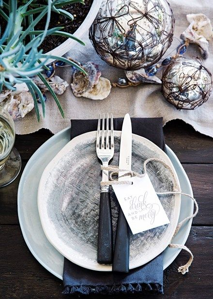 Dark navy napkins and silver baubles scattered across the table reference a glamorous bottom-of-the-ocean scene. 'Paris' ceramic plate (top) from MH Ceramics and baubles from My Brother Albert.  Home Beautiful Magazine Australia