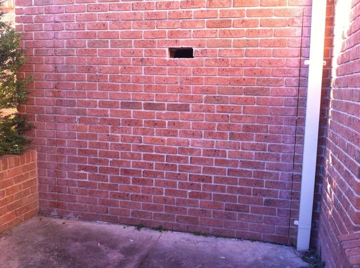 Bricks cut for roller door for third garage.