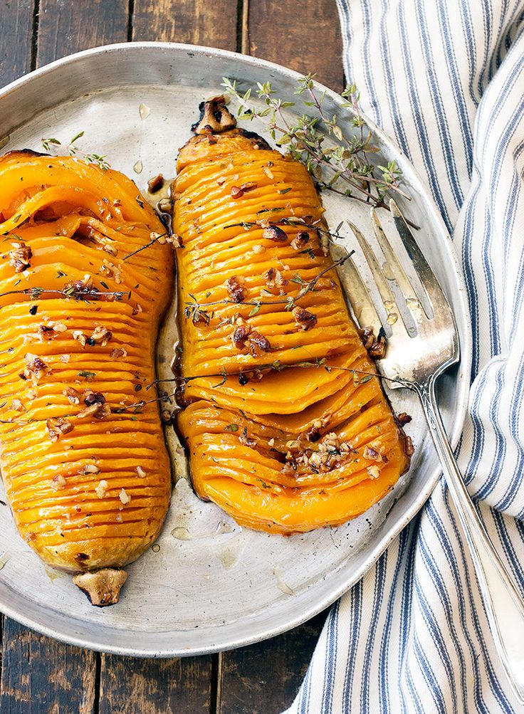 Butternut squash halves, cut hasselback style and roasted with maple syrup and butter, flavoured with thyme and topped with chopped pecans.