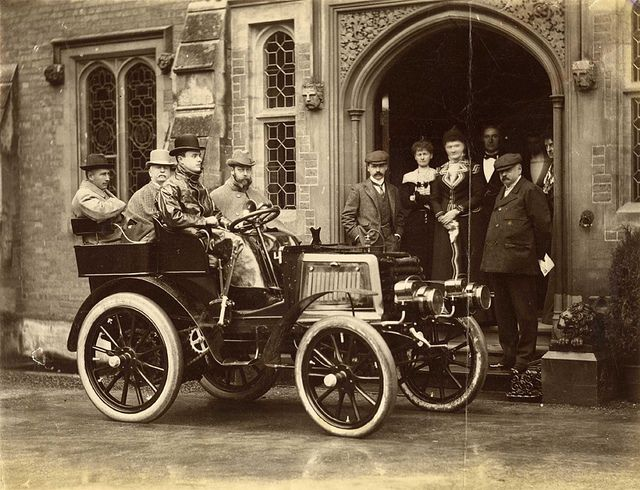 """The Original Rolls - """"Photograph of the Hon. C.S. Rolls' autocar with HRH The Duke of York, Lord Llangattock [Rolls' father], Sir Charles Cust and the Hon. C.S. Rolls as occupants"""", taken by John Howard Preston. Charles Stewart Rolls went on to co-found Rolls-Royce in 1904. The photograph shows 'The Hendre', the family's gothic mansion in Monmouthshire. Date: 1900"""