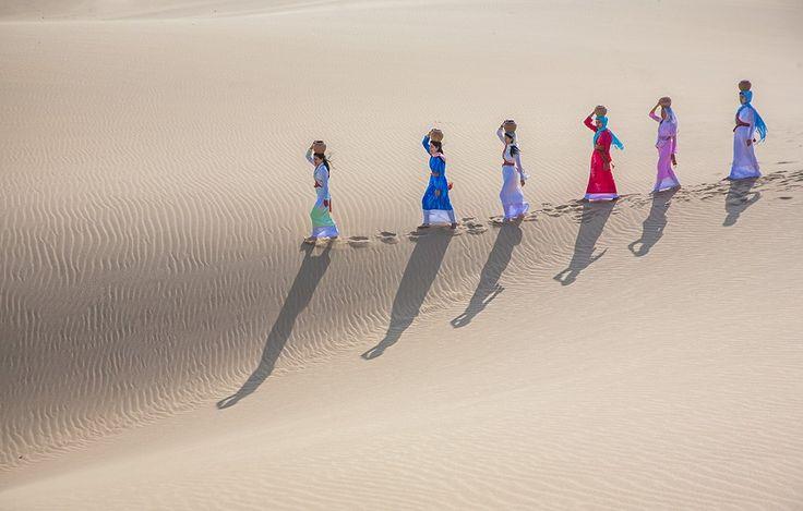 Cham Women Carrying Water Pot by Jungshik Lee