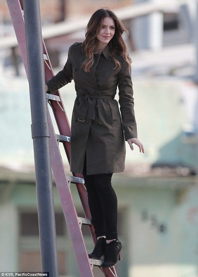 Sure footed: Katharine McPhee didn't look shaken at all as she scaled a ladder on set for ...