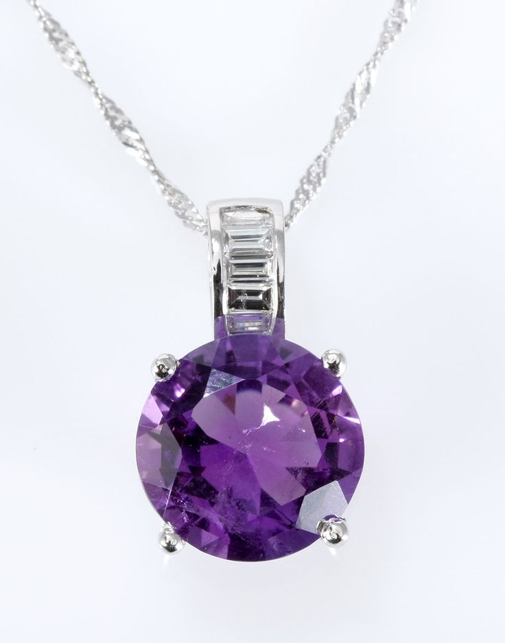 AN AMETHYST PENDANT  claw-set with a round amethyst weighing approximately 2.42cts, the bale-set with baguette-cut diamonds weighing approximately 0.15cts in total, in 18ct white gold, on a 9ct white gold twist chain, length approximately 440mm