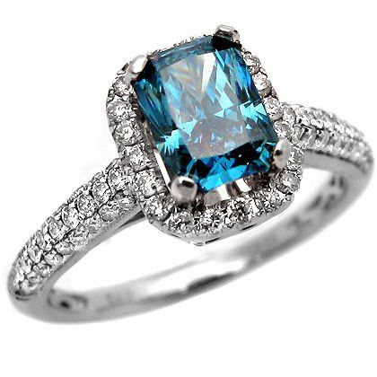 Blue Round & Baguette Diamond Engagement Ring - Here's a fancy Blue Round & Baguette Diamond Engagement Ring stamped in 14k White Gold that features a 1.11 carat Blue Round center stone surrounded by 1.40 carat Round & Baguette cut accent side stones. The Baguette accented ring comes with a VS1-VS2 in clarity & E-F in color for the accent stones & the blue diamond comes with an SI-1 in clarity. The total gem weight is equal to 2.51 carats & the diamonds are 100% natural…