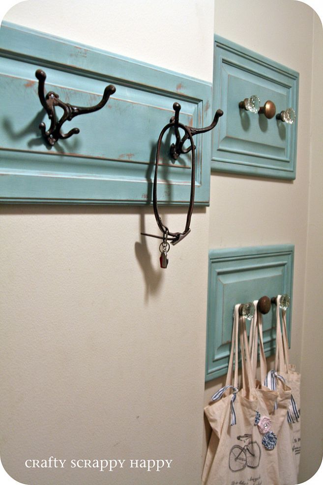 Get rid of coat clutter when you put up hangers made from repurposed cabinet doors.