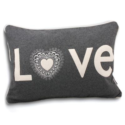 A wool felt feather filled cushion with complementary piped edge to show your home some love.