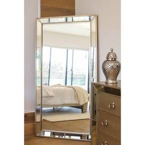 """Add a distinguished air to your room with the Abbyson Desmond Leather Floor Mirror. This full length mirror would look fab in your bedroom. Easily match this leather mirror to your décor. If you're looking for a mirror that's a little more unique you will love this cool floor mirror. Measures 70"""" x 30"""" x 2""""."""