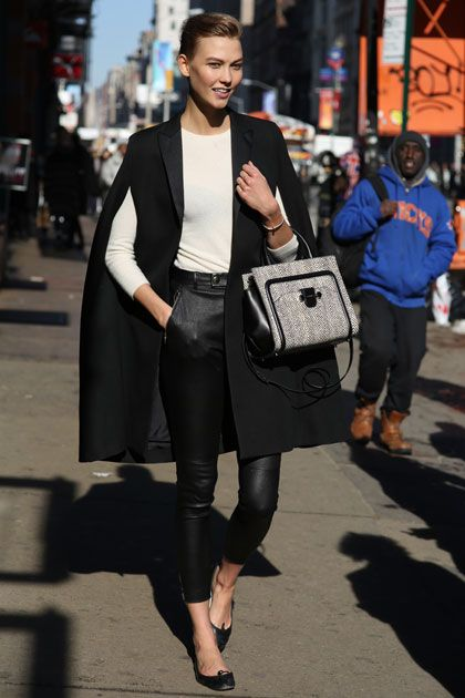 Yes, Karlie Kloss is wearing a cape with armholes. Yes, she's the best.