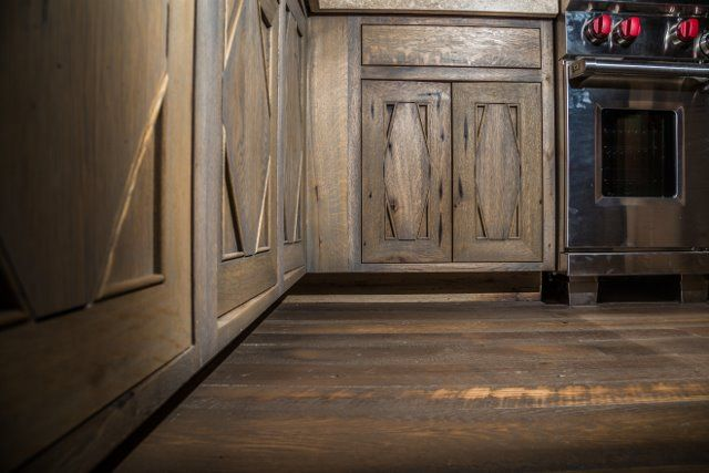 Old wood given a new life as beautiful cabinets and flooring.