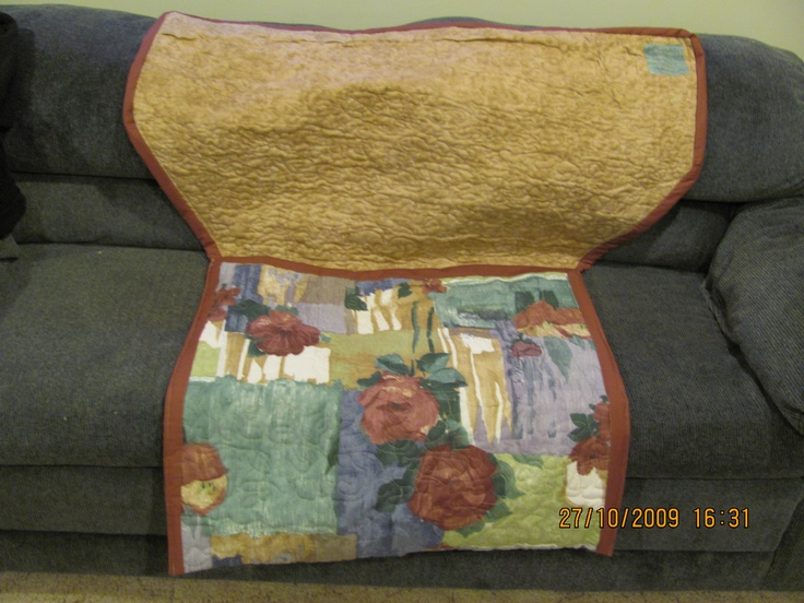 Back of Wheel Chair Coverlet.    Feet tuck into Foot Pocket. $75.  Plus Handling and Shipping.    marilynpearson2@gmail.com