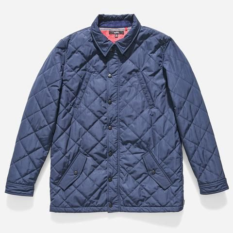 Quilted, collared jacket with waist and chest pockets, snap button closure and internal yarn dye flannel lining.