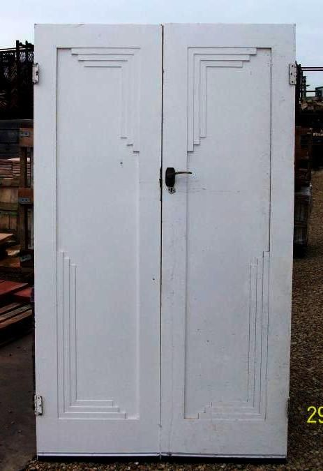 Unusual Art Deco double interior wardrobe doors with geometric panels. Doesn't look like any wardrobe I've ever seen before - idea could be to use upcycled doors (from a doorway) and custom make a wardrobe?
