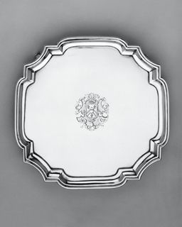 Silver Slaver by John Tuite a French Huguenot refugee in London early 1730s  Production of these types of salvers is shown to have peaked between about 1725 and 1733. The engraved cartouche is in the conventional late baroque style that was widely practised in London There are traces of a lozenge-shaped shield beneath the arms suggesting that this salver was re-engraved at an early stage