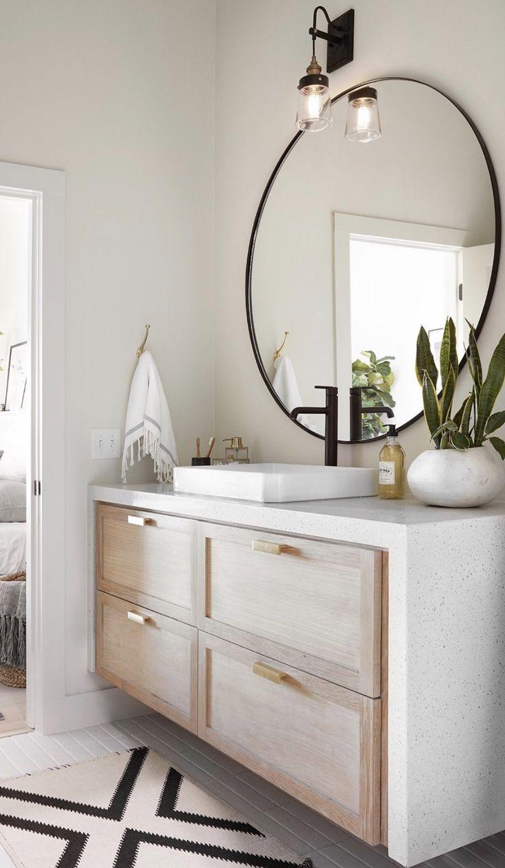 Neutral Bathroom With Large Circle Mirror Simple Bathroom