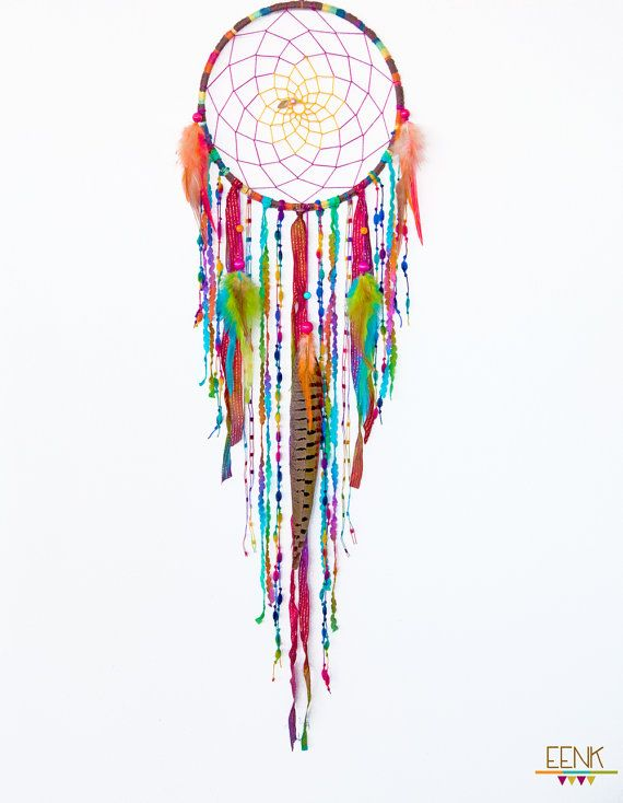 This OOAK dreamcatcher features my signature weaving pattern with rainbow colored natural hemp. The web in the middle has an ombre effect with the fuschia