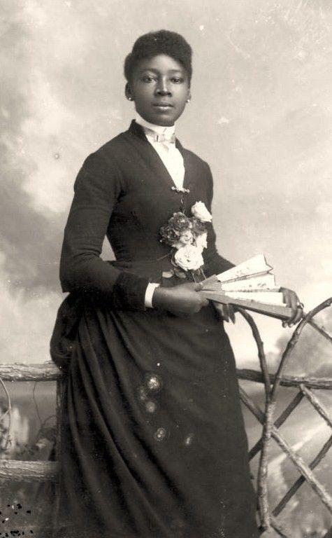 1880s - Woman with a fan.