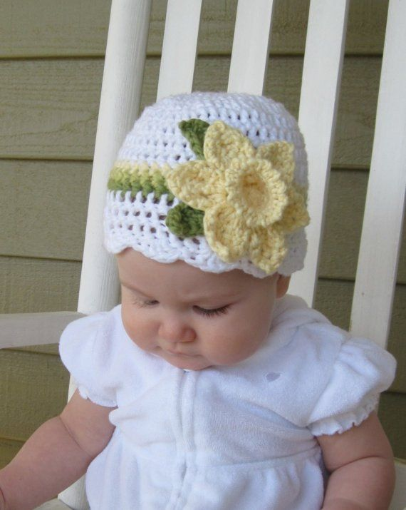 Crocheted Daffodil Hat~Inspiration- use daffodil pattern from here... http://www.crochetme.com/media/p/94557.aspx . May need to enlarge flower but colors in this hat are great