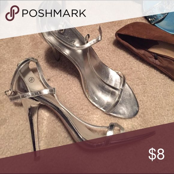 Silver strappy high heels Silver strappy high heels, used but in very good condition Shoes Heels
