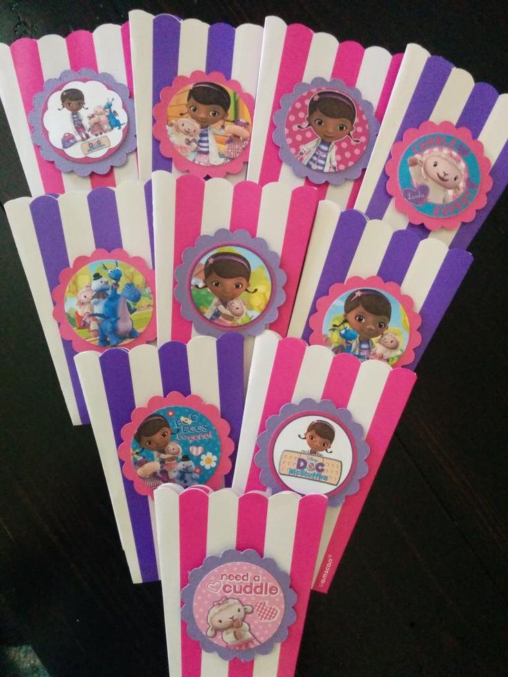 Doc McStuffins popcorn boxes, Doc McStuffins Birthday, Doc McStuffin's party decorations by SweetBugABoo on Etsy https://www.etsy.com/listing/198796048/doc-mcstuffins-popcorn-boxes-doc