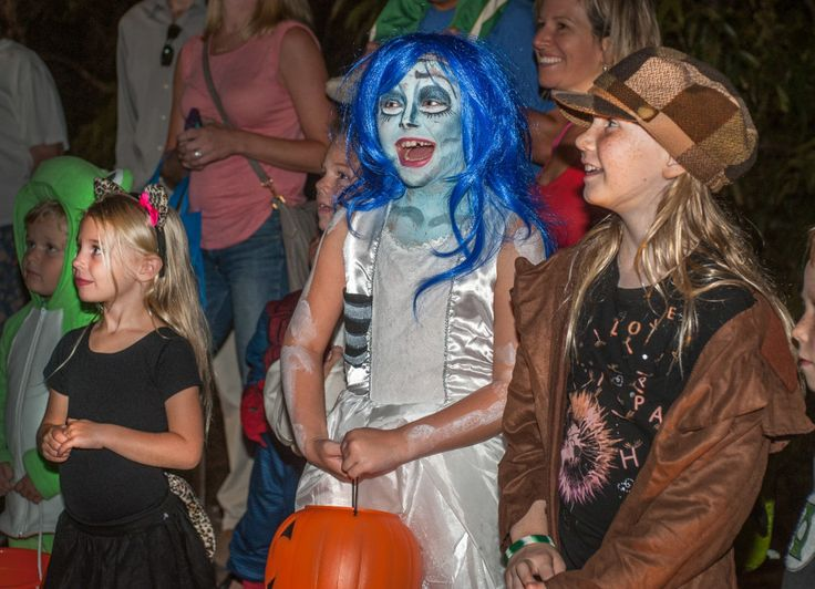 JOAN PAHOYO/Acorn Newspaper Meredith Butler, 5, of Ventura, Natalie Geer, 8 of Simi Valley and Kara Gusner, 9, of Thousand Oaks enjoy the Minions on the trail at the Thousand Oaks Community Center on Saturday, October 24, 2015 during the Annual Haunted Halloween Trail.