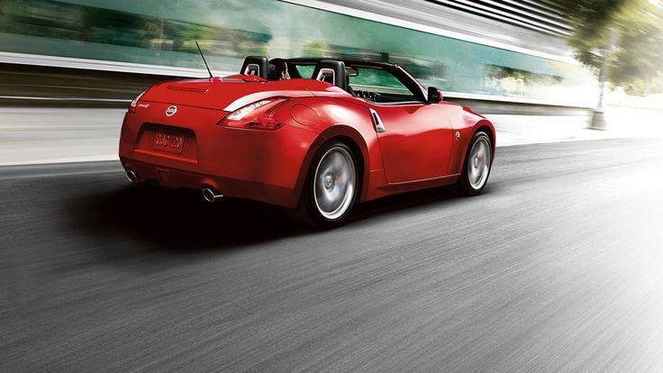 Good 2016 Nissan 370Z Roadster Convertible Sports Car Rear View Shown In Solid  Red Driving At Speed