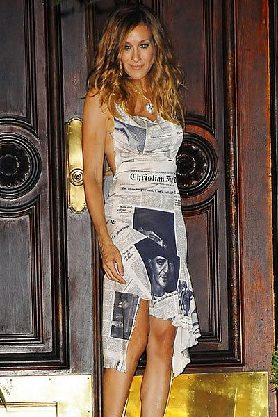 Carrie Bradshaw, in THE Dior newspaper dress.    One of my all time couture moments.