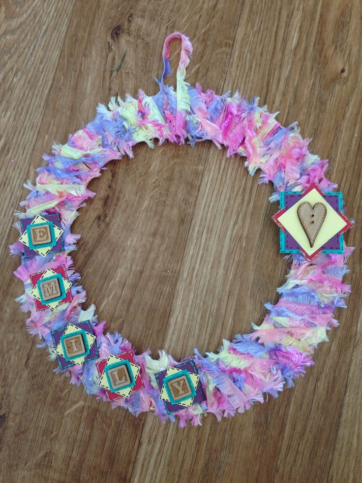 My 9yr old daughter made a wreath for her bedroom door using old scrapbooking card, spare embellishments & old wool.