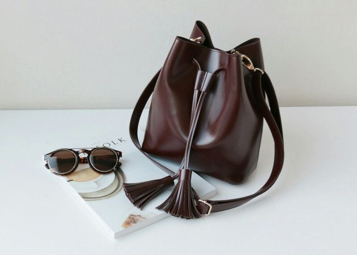 Tassel bucket bag is very comfortable and extremely light weight. It's lightweight and nice mid size will be your perfect companion during summertime. Our handbags have developed a strong following, which makes us happy to offer you this bag, handcrafted exclusively for You. Each bag is made from the heart and hands of the artisan.  kakuubasic.com