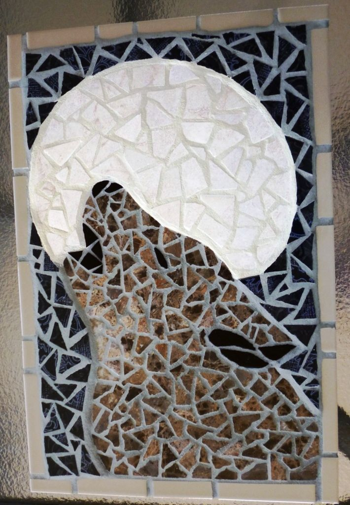 A mosaic wall hanging of a Wolf.  Made for my niece Chloe.