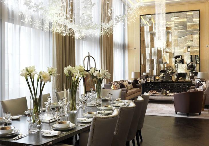 White & gold colour theme in a Candy & Candy property, great use of chandeliers and large mirror, further enlarging the interiors.