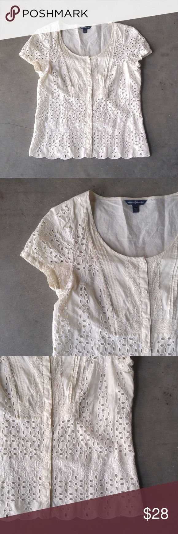 American Eagle Ivory Eyelet Top American Eagle Outfitters top, size small, in excellent condition! Adorable and dainty, this top has eyelets throughout the front (lining across chest but not below it). Features cap sleeves, a scoop neckline, scalloped edge bottom hem, and buttons down the front. Color is a slight off-white ivory color. Very slight pit wear/discoloration. No trades. No modeling. Make a reasonable offer. Thanks! American Eagle Outfitters Tops Blouses